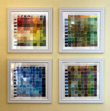 watercolor mix charts framed and mounted on a wall